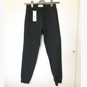 NWT Adidas Reigning Champs sweatpants
